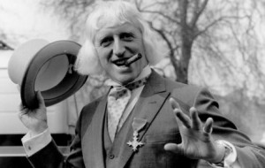 Jimmy Savile sporting his OBE at Buckingham Palace 1972. Click to enlarge