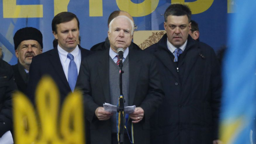 John McCain can be seen here speaking at a rally organized largely by the Neo-Nazi Svoboda movement in Kiev, Ukraine, Sunday, Dec. 15, 2013. To John McCain's right is neo-Nazi leader Oleh Tyahnybok and to his left is US Senator Chris Murphy (D) Connecticut. Click to enlarge