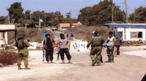 The undated photo obtained by Press TV shows Israeli soldiers speaking face-to-face with foreign-backed militants near the Israeli occupied Golan heights in Syria.The photos obtained by Press TV show Takfiri militants from the terrorist al-Nusra Front, which is linked to ISIS, with Israeli soldiers. Click to enlarge