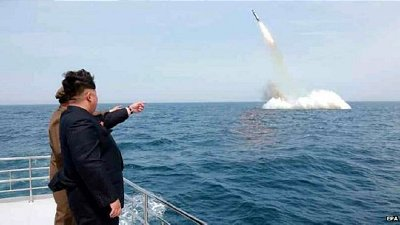 Kim Jong-un watches the launch of a submarine launched ballistic missile