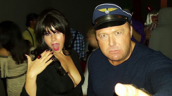 Divorcee Alex Jones with Lee Ann McAdoo at an Infowars Halloween party. Jones was more than happy to post this photo to his Twitter page.
