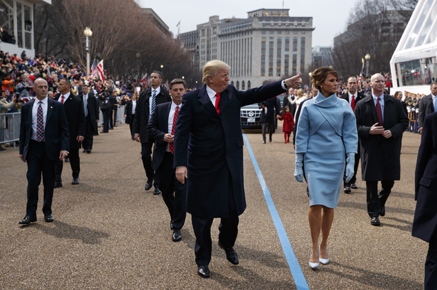 President Donald Trump walks with first lady Melania Trump walk along the inauguration day parade route after being sworn in as the 45th President of the United States, Friday, Jan. 20, 2017, in Washington. (AP Photo/Evan Vucci, Pool)