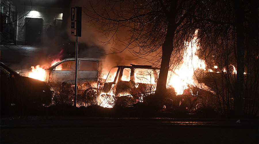 Burning cars in Rinkeby, Stockholm. Click to enlarge