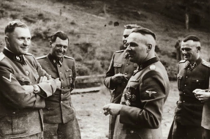 SS officers at Auschwitz. From left to right: Richard Baer, Josef Mengele, Josef Kramer, Rudolf Höss (From the so-called Höcker Album, USHMM Archive). Click to enlarge