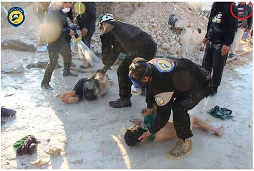 Image released by the Syrian White Helmets which shows rescue workers handling victims with their bare hands and inadequate gas masks, undermining claims of sarin usage