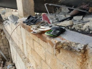 The family's plastic shoes remain after four members of the al-Khater family died when a Turkish shell hit their home in Maabatli, Kurdish Syria (Robert Fisk). Click to enlarge