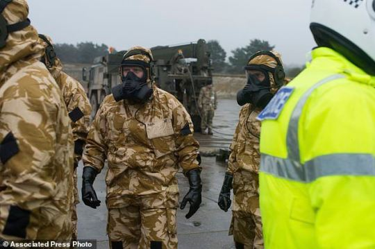 Members of the Falcon Squadron, Royal Tank Regiment, at Winterbourne Gunner, southern England, conducting final preparation and training before deploying in support of the civil authorities in Salisbury city centre, Friday March 9, 2018. British police asked the military on Friday to help investigate the nerve-agent poisoning of a former spy, as investigators' attention increasingly focused on the victim's house in a quiet suburban street. (Cpl Pete Brown/Ministry of Defence via AP). Click to enlarge