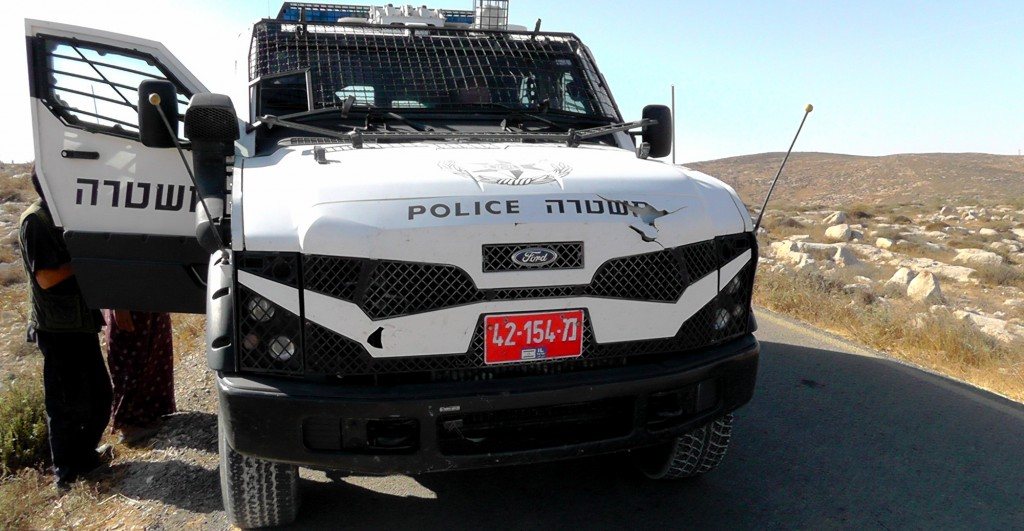 A modified Ford vehicle belonging to Israeli police blocks Palestinian shepherds from accessing their land near a Jewish settlement in Hebron. Photo   Ta'ayush. Click to enlarge
