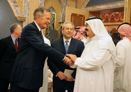 Former President George H.W. Bush is greeted by newly crowned King Abdullah during a retreat at King Abdullah's estate in Riyadh, Saudi Arabia, August 5, 2005