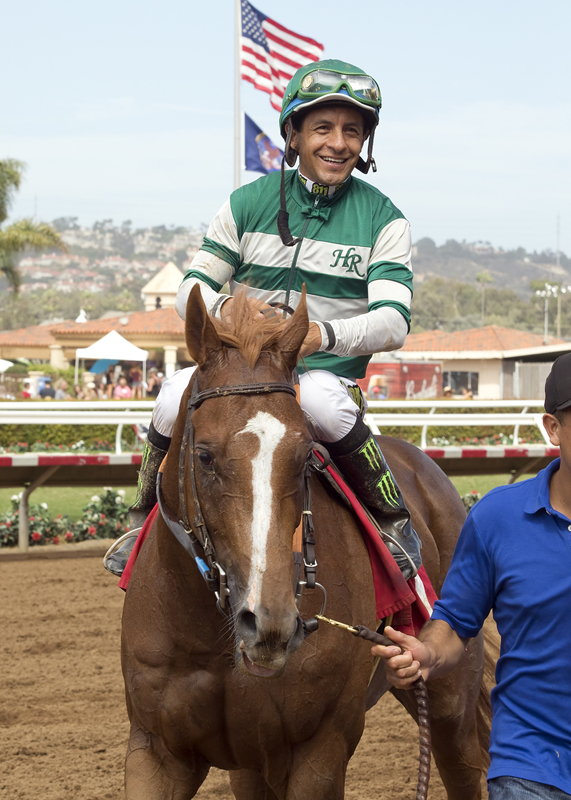 Stellar Wind and jockey Victor Espinoza are guided into the winner's circle after their victory in the $100,000 Torrey Pines Stakes at Del Mar. © BENOIT PHOTO