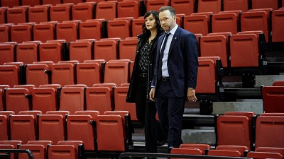 Danny Reagan and Maria Baez standing in some bleachers during an investigation