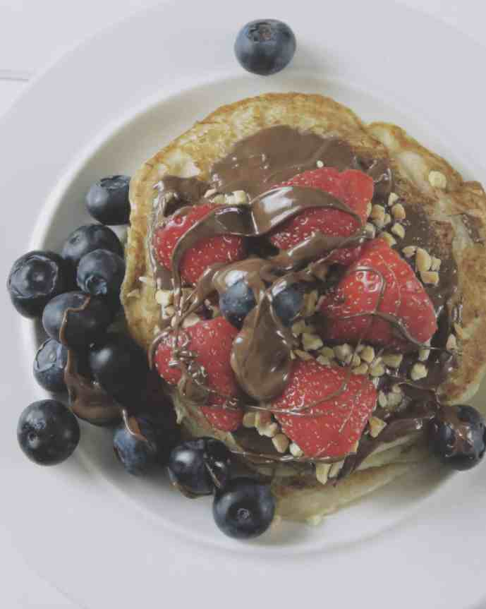 Eggless Pancake Recipe — light and fluffy served with Nutella and soft fruit
