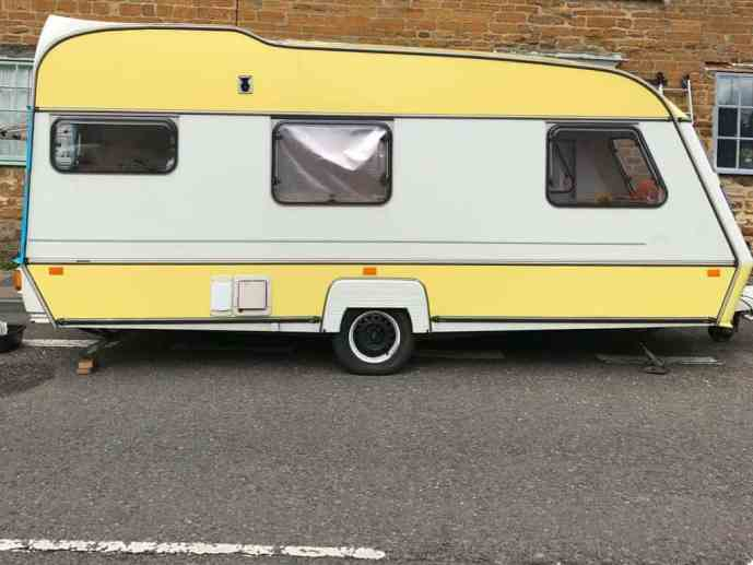 Dolly the yellow and white caravan