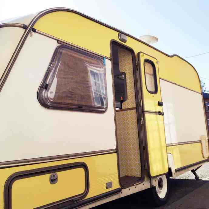 Our little yellow and white caravan! Dolly the caravan after her makeover.