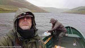 bailing the boat on a miserable day