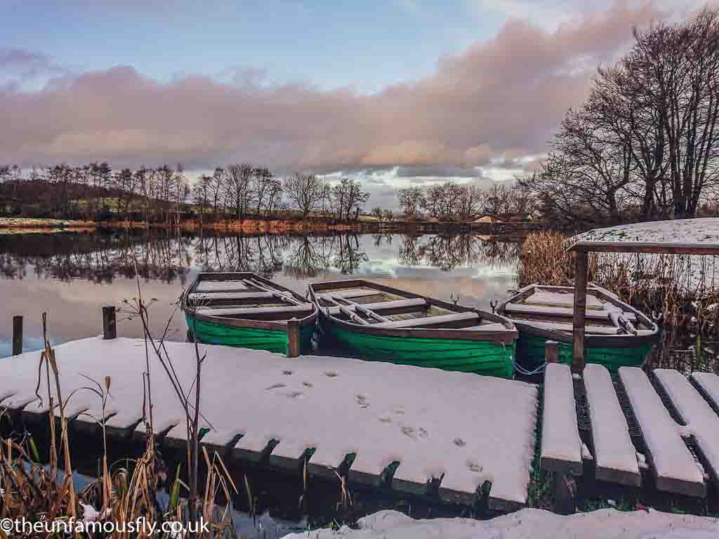 Boats in the snow at Swanswater