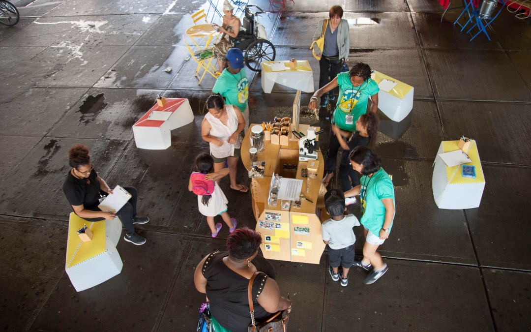 Street Science: the Uni EXPLORE cart on 125th Street in Harlem