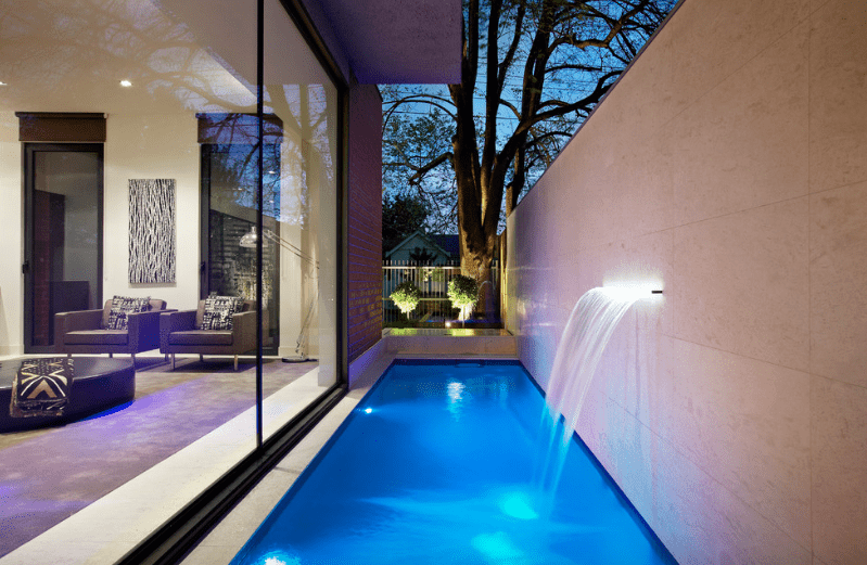 Pools with a water feature design ideas