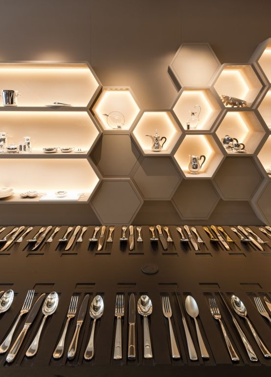 10. Hexagon shape idea inspiring from honeycomb, back light used to highlight the product also giving a honey look