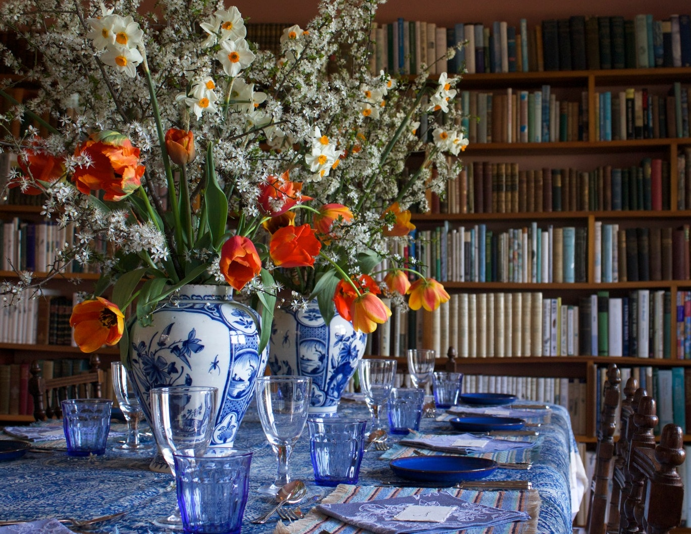 1. The bright orange flowers pair perfectly with the blue and white ginger jars, linens, and tableware.
