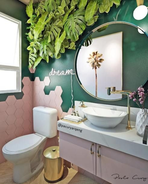 44. Beautiful Blush pink Hexagon tiles fusing with green tiles and planters bring the space alive