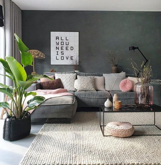 Amazing L shape Sofa for Living room with cute cushions and house plant