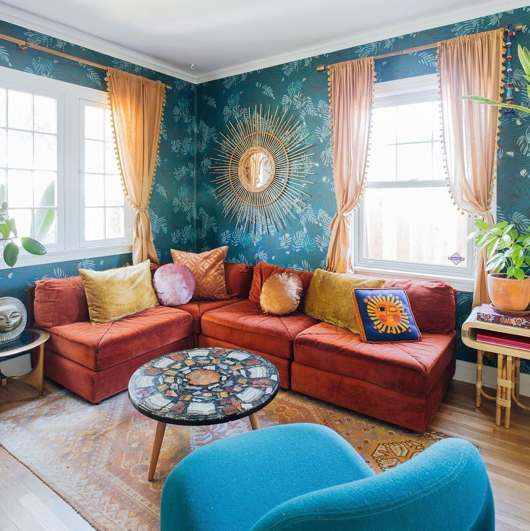 Colorful Home With L Shape Sofa, Pretty Curtains, Centre table and Chair