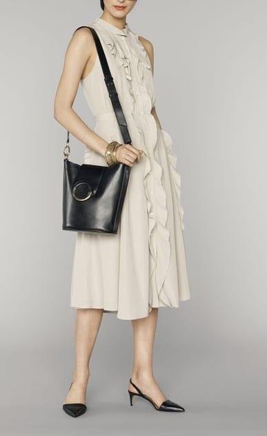 pair sling back heels with knee legth dress