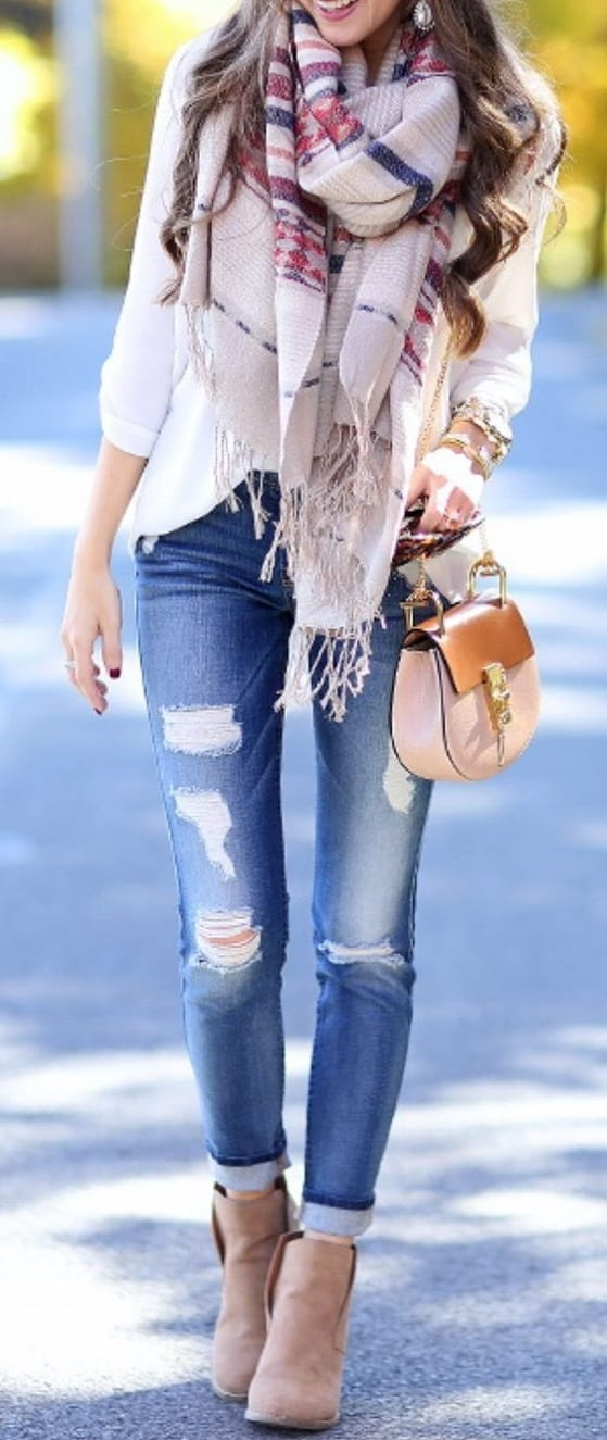 style ankle length boots with ripped jeans
