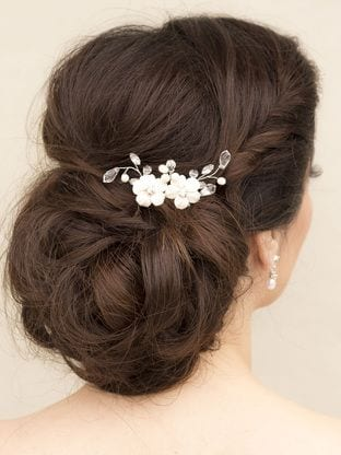 low chignon with hair accesory