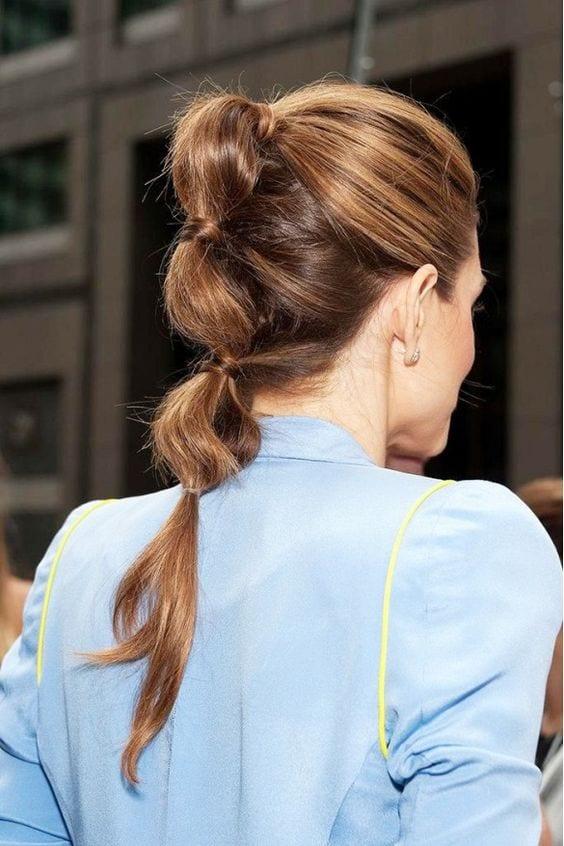 three poufed ponytail