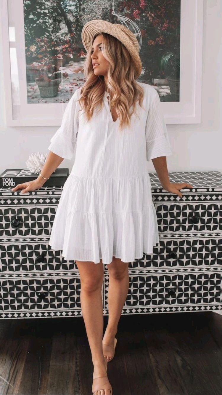 Chic White Dress Outfit styled with a hat for a easy beach look