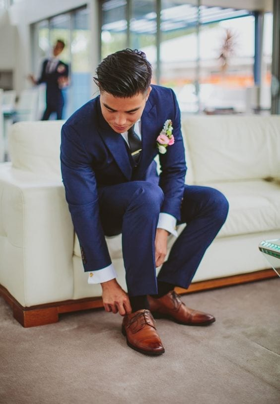 blue suit with brown dress shoes