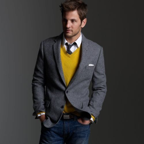 yellow sweater vest with grey blazer