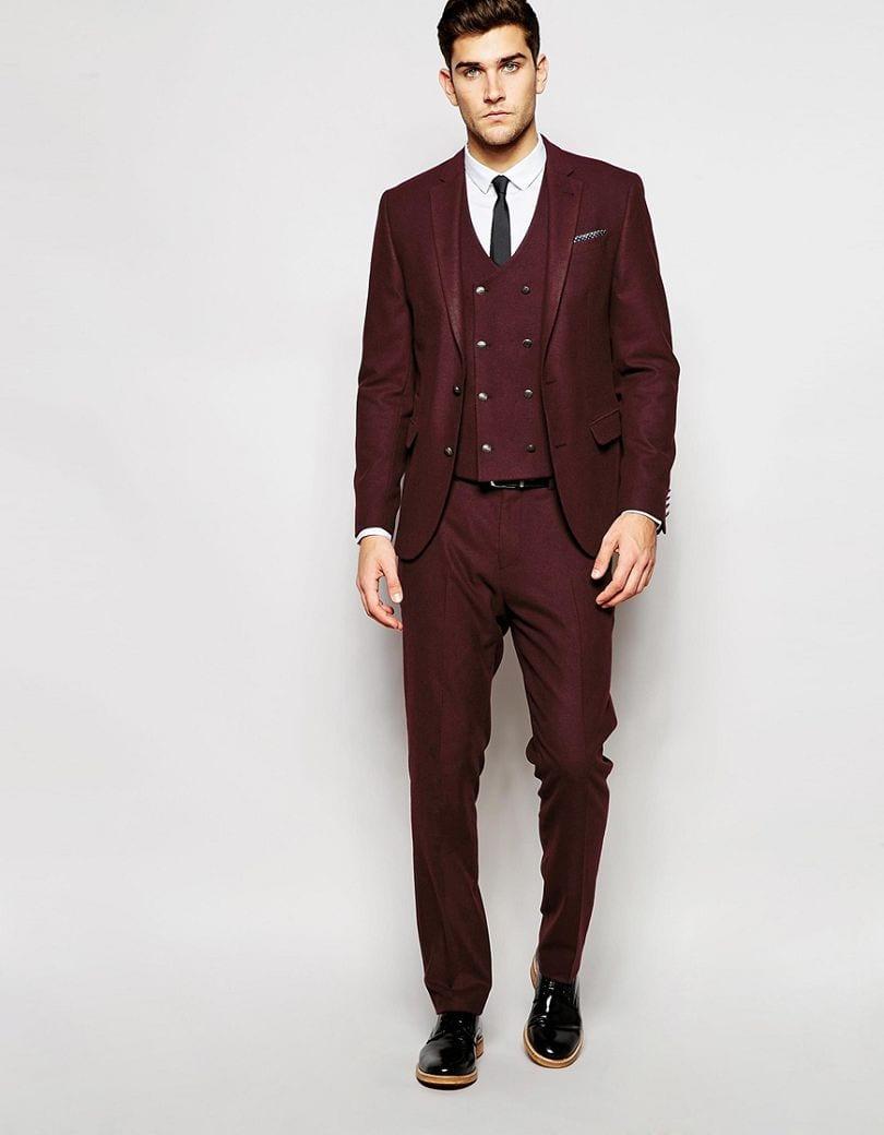 Burgundy suit with black shoes black tie and black belt