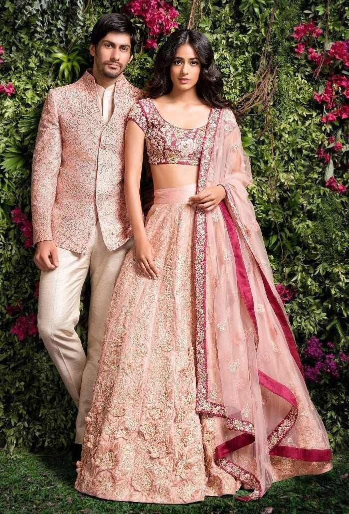 Contrasting colour Sherwani and lehenga for Sangeet