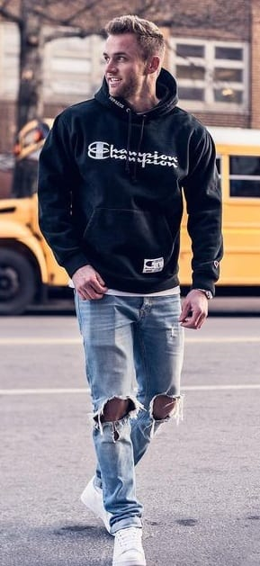 blue ripped denims with sweatshirt