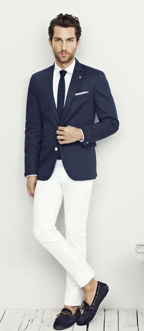 navy blue suit jacket with white trousers