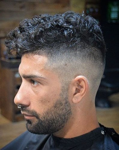 undercut curly with stubble