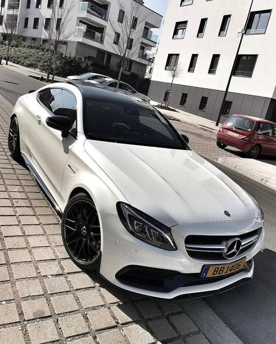 WHITE MERCEDES COUPE