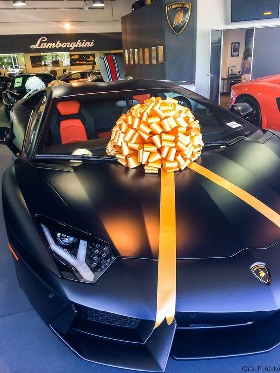 Black Matte Lamborghini with a golden bow