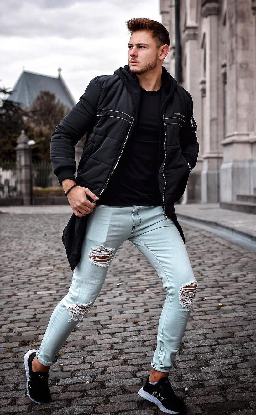 Black jacket,black t-shirt with blue distressed denims