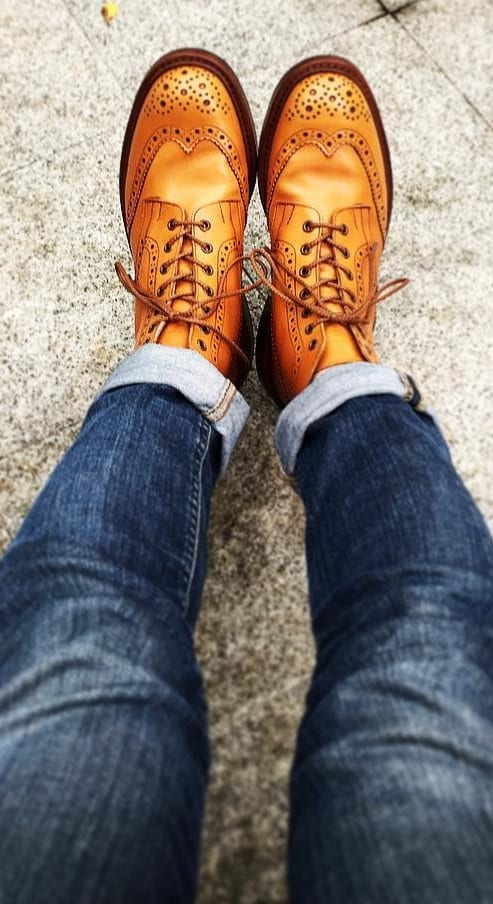 Brown winged brogues with blue denims for men