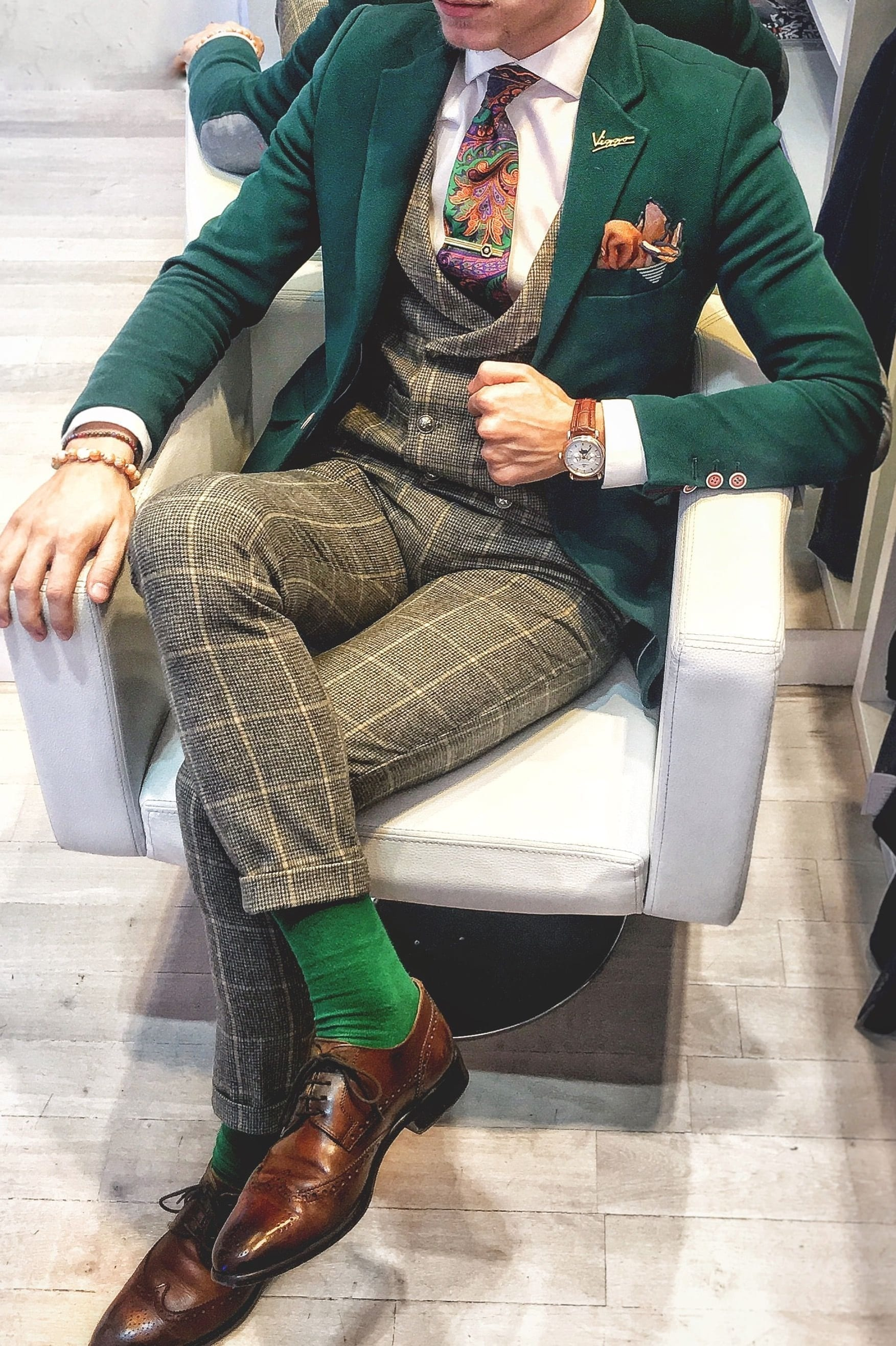 Green suit with funky tie,socks,lapel and pocket square