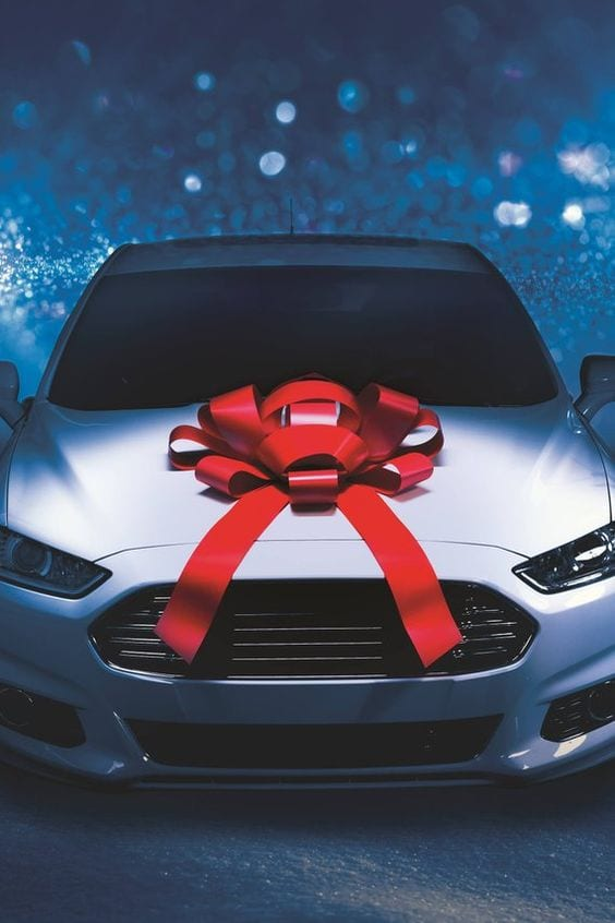 White car with bow for gift