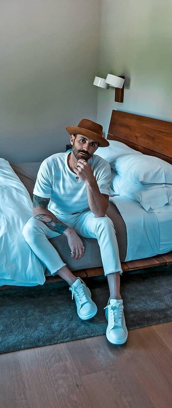 White stripped t-shirt white cropped trousers and hat