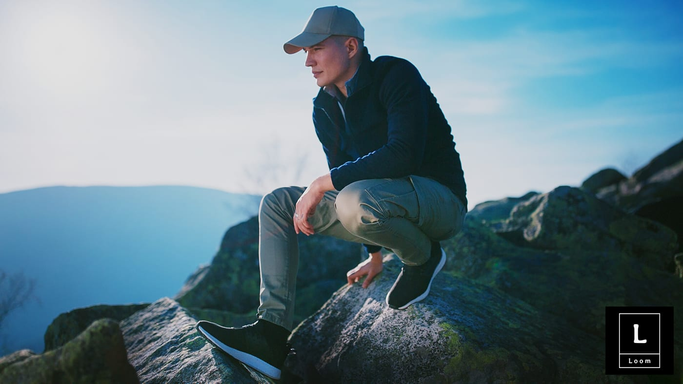 young-men-hicking-top-montain-black-sneakers-hat