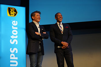 Robert Herjavec and The UPS Store employee on-stage