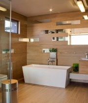 contemporary-bathroom-with-white-square-freestanding-soaking-bathtub-and-white-wall-hung-toilet-also-mirrored-tile-and-laminate-wooden-floor-siding-1024×1089