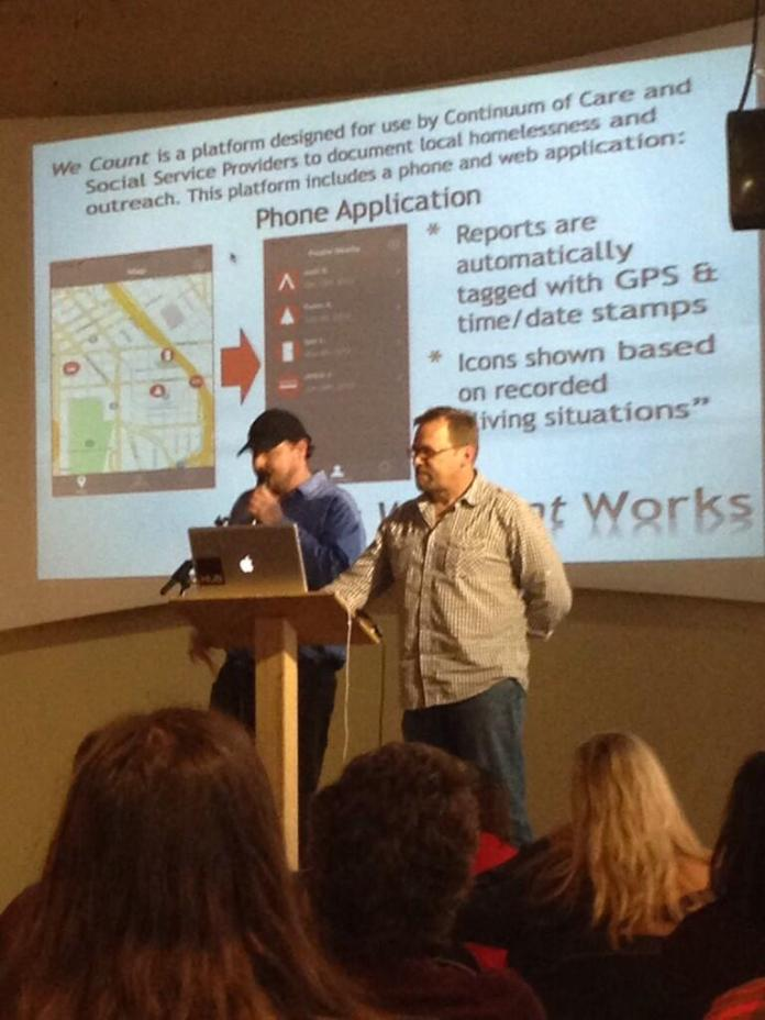 Graham Pruss and Jeff Lilley demo their app for surveying the needs of people living on the streets.